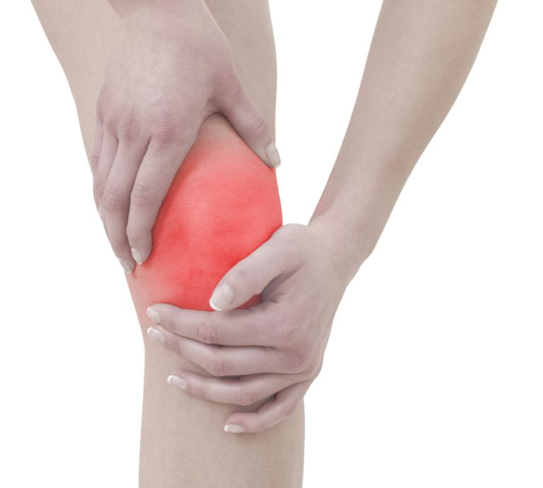 person holding knee in pain